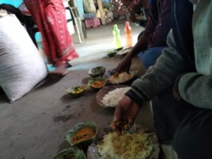 Relishing the lunch at Guru's home